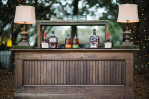 Wooden Whiskey Bar With Moss Accents