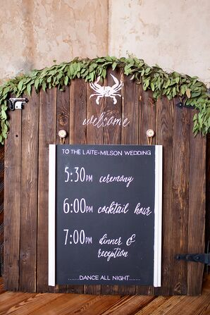 Wooden Chalkboard Itinerary With Greenery