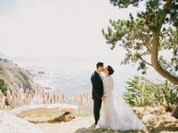 Bride and groom on mountain in California