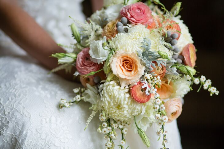 "Madeline knew she wanted some pops of color in her bouquet that really matched her bold palette, but she also wanted more traditional ivory flowers to be mixed in. ""Dawn at A Floral Affair was able to take what I liked to develop a bouquet that was absolutely stunning,"" Madeline says of her spider mum, rose, silver brunia ball, ranunculus and dusty miller bouquet."