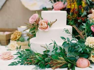 Simple wedding cake with fresh flowers