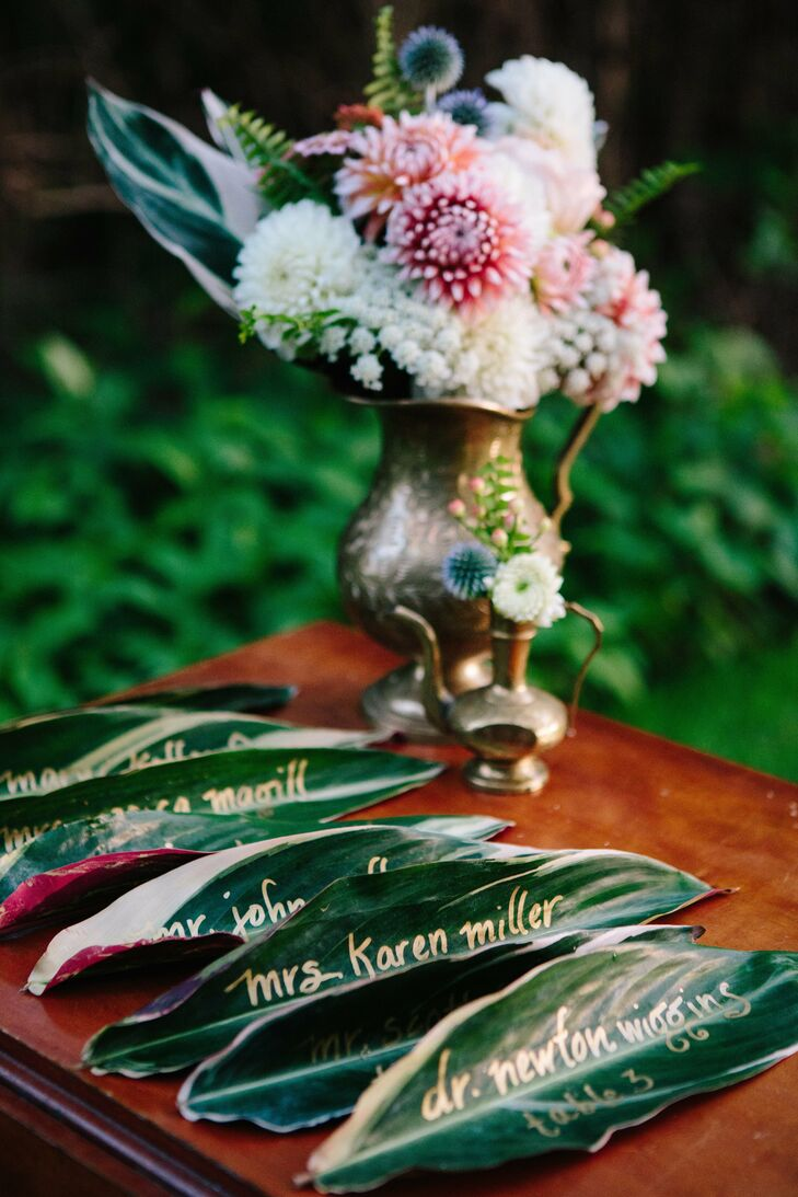 Each escort card featured the guest's name written in gold on a blush maranta leaf.