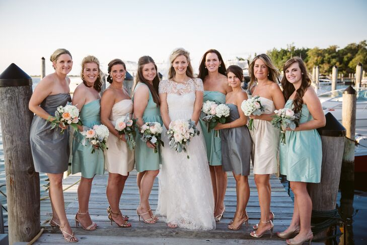 Using the seaside locale as inspiration, Jill selected a color palette of three colors — mint, gray and champagne — for the bridesmaid dresses. She found the perfect style at J.Crew, which had a strapless neckline, flattering A-line silhouette and draped detailing at the bodice. The girls paired the look with metallic sandals and understated jewelry.