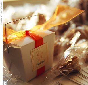 Guests received custom-made fortune cookies, which Caroline and Jonathan had placed in Chinese take-out boxes and tied with orange ribbon and monogrammed tags.