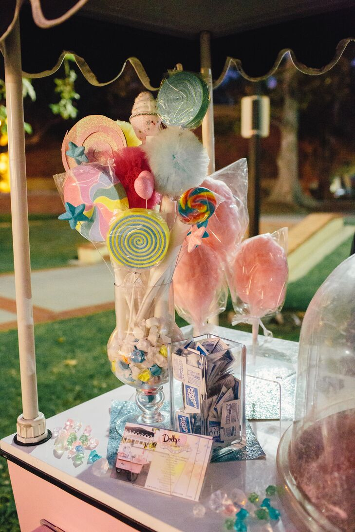 """""""Dolly's Cotton Candy helped us create our centerpieces. We filled long square vases with multicolored sprinkles and stuffed freshly made cotton candy on a stick in the center,"""" says the couple."""