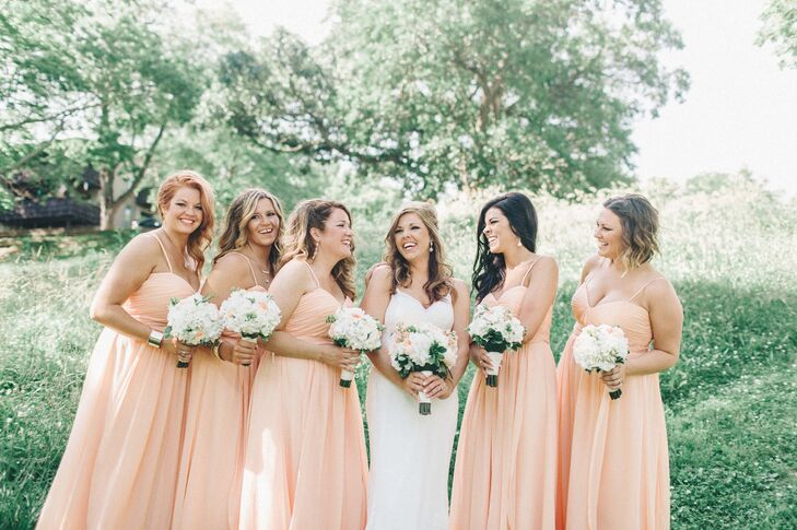 The bridesmaids wore floor-length strapless gowns in apricot, a soft, peachy color.