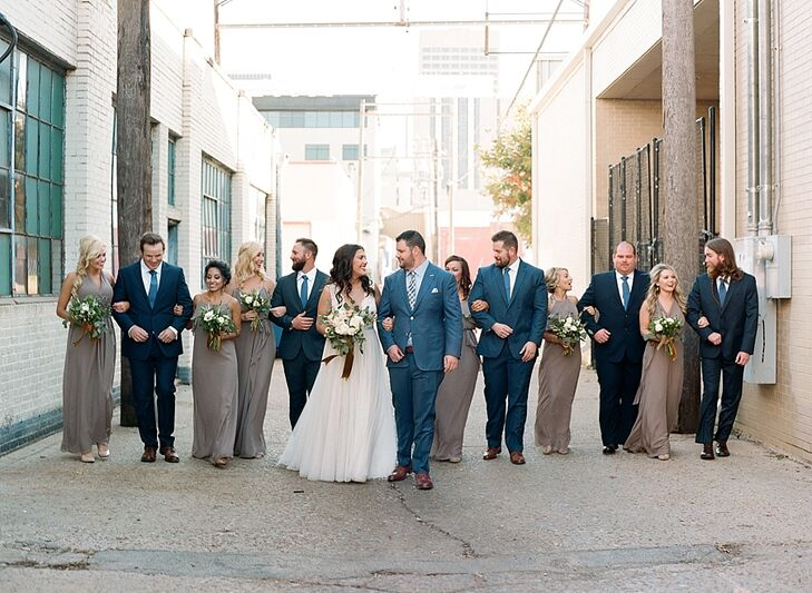 In keeping with letting their bridal party show their individual style, the five groomsmen wore their own navy suits and brown shoes with matching socks and ties. Each bridesmaid chose the style that suited her personality.