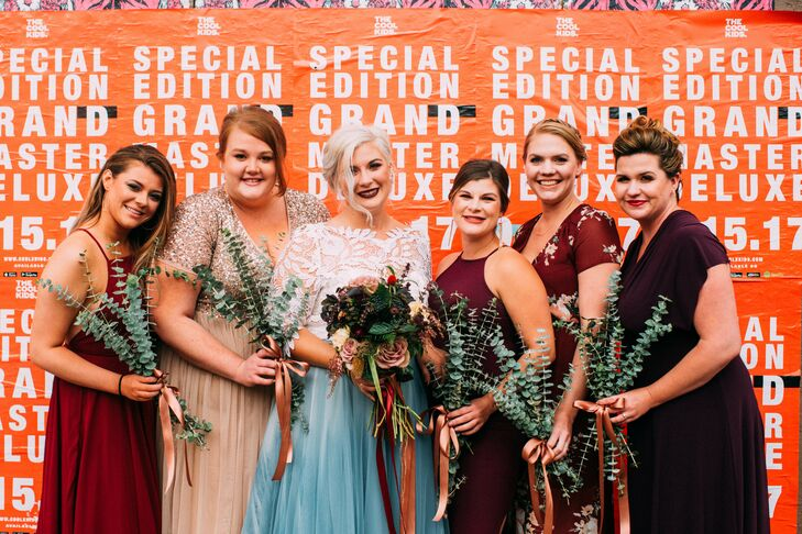Bridesmaids Dressed in Fall Colors and Holding Eucalyptus Bouquets