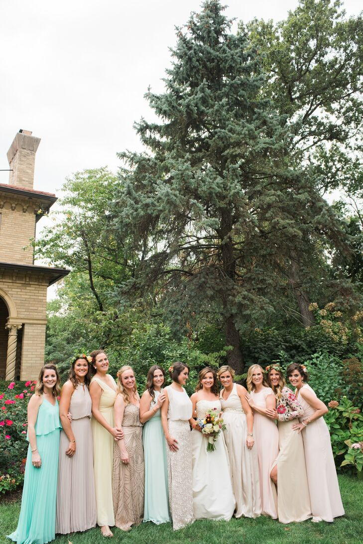 The bridesmaids chose their own long dresses in any style and color of their preference, but Kassie's two sisters wore off-white dresses to coordinate with Kassie's gown. The groom and groomsmen wore classic black tuxes.