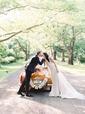 Couple Sharing a Kiss by Getaway Car at Pennsylvania Wedding