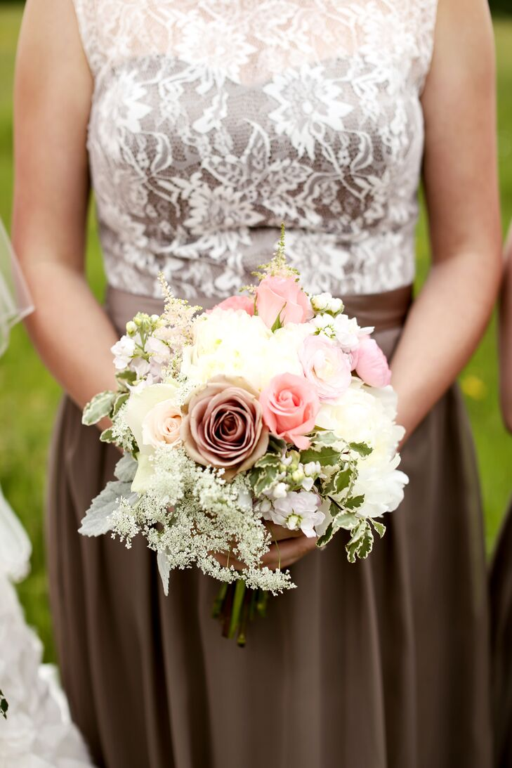 The bridesmaids carried champagne-colored roses, blush roses, white baby's breath, white sweet peas, blush astilbes and mint dusty miller in their bouquets. The arrangements, gorgeously done by Toni's Flowers, echoed Katie's bouquet for a cohesive look.