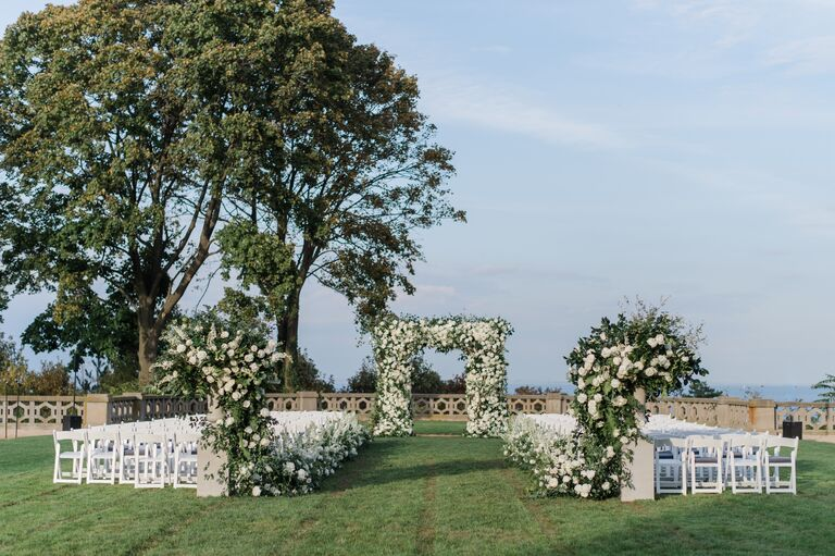 The Knot Dream Wedding 2017 ceremony arch with white roses