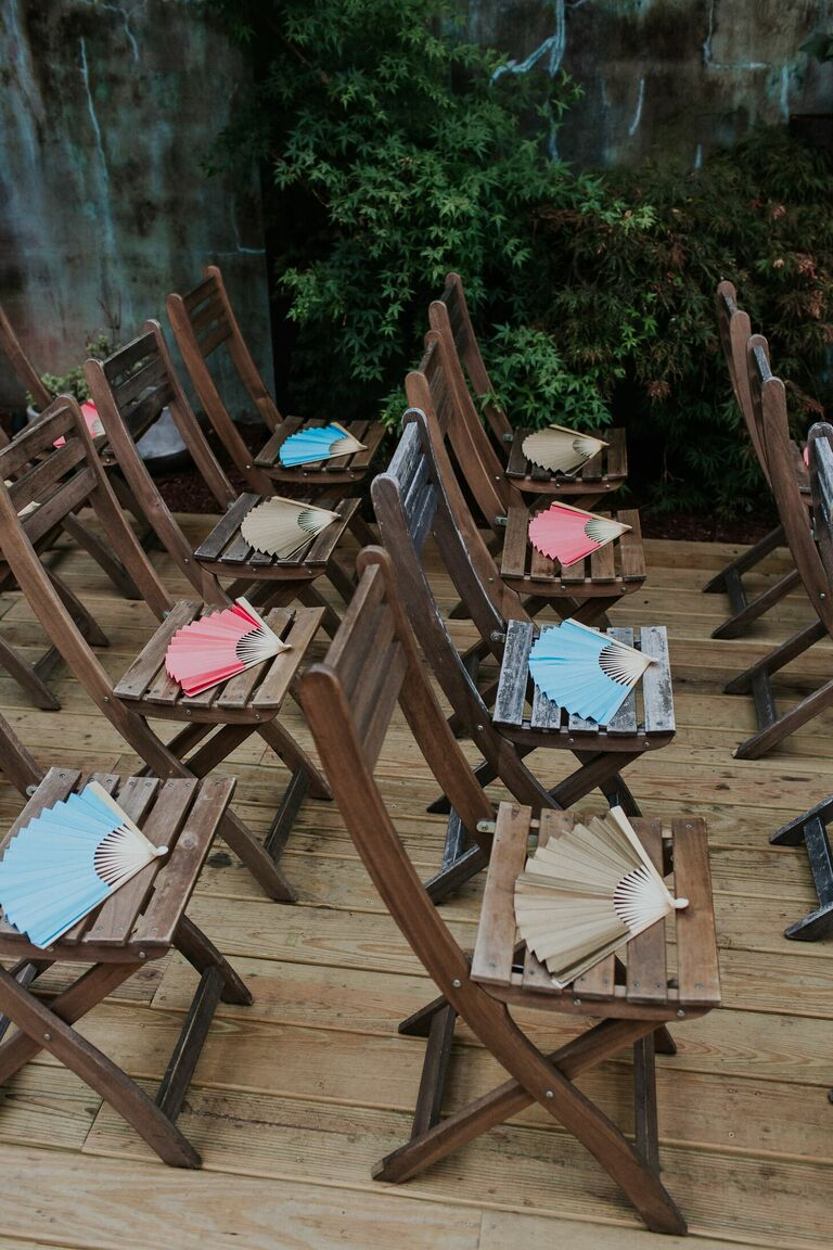 Fans on folding chairs at wedding ceremony