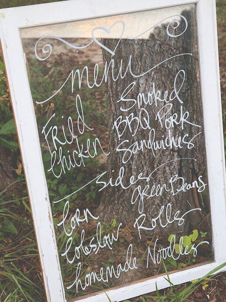 DIY wedding menu sign calligraphed on a large photoframe