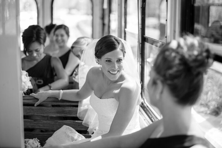 """Between the wedding ceremony and reception, the wedding party rode in an old-fashioned trolley car to take wedding pictures throughout downtown Chicago. """"This was a fun time to relax with friends and take in the amazing views before the party started,"""" Alison says."""