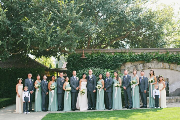 From start to finish, Jessica and Brent's wedding exuded sophistication and elegance without venturing into stuffy territory. The couple's choice in attire reflected this, with Brent's groomsmen suiting up in sharp gray suits and classic blue ties instead of the standard black tuxedo.