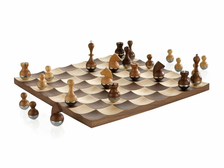 wood chess set with concave board and wobbly pieces