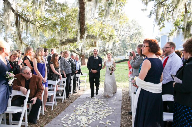Since Emily and Matt wanted a ceremony focused on their religion, they accented the natural ceremony space with only a few details. White and yellow petals covered the aisle as a lavender runner stretched across the ground to their altar.