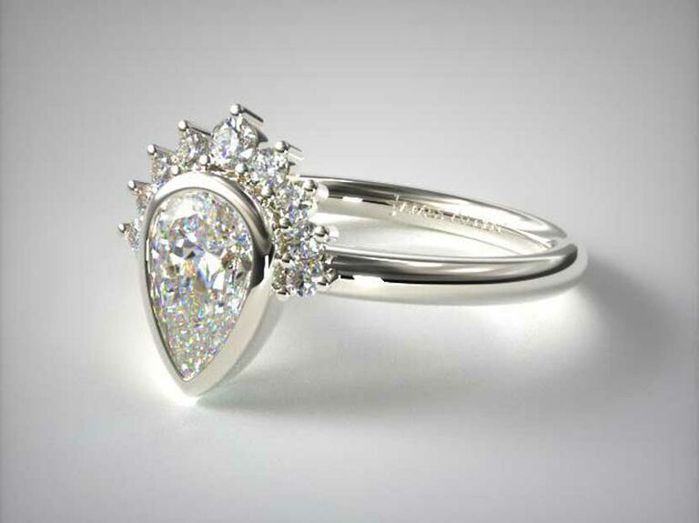 Pear-cut bezel set engagement ring with tiara halo