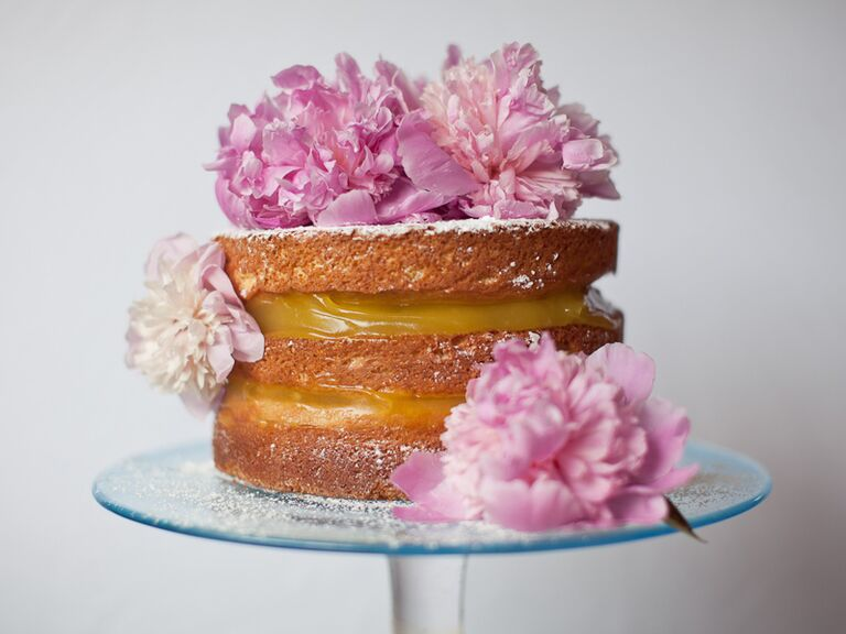 Naked bridal shower cake with pink fresh flowers