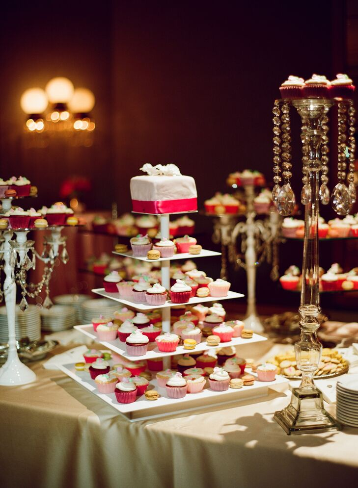 The couple served cupcakes, macarons and other sweets instead of a traditional cake. A Piece of Cake made a top tier of a cake just for the couple.