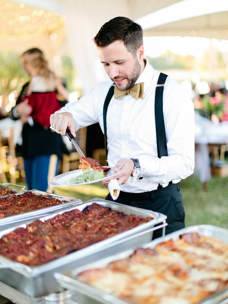 Wedding guest at self-serve barbecue food station at outdoor summer wedding