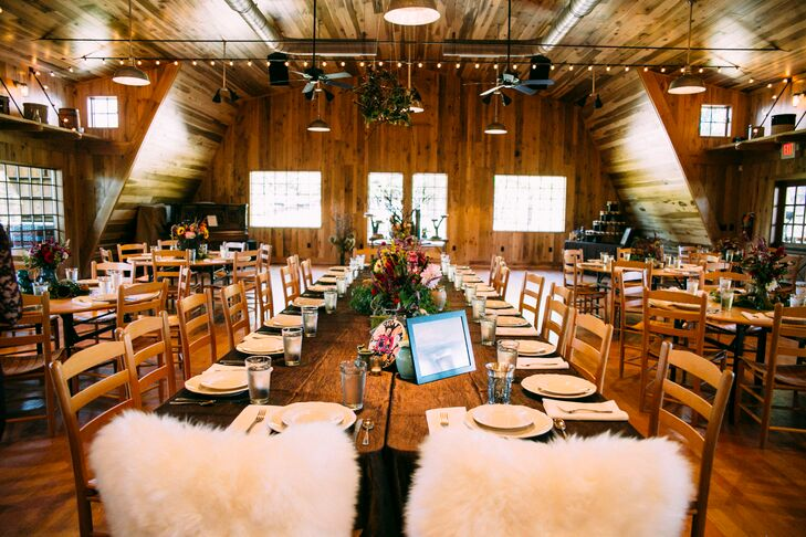 Andrew's New Zealand heritage inspired their rustic-chic barn reception decor.