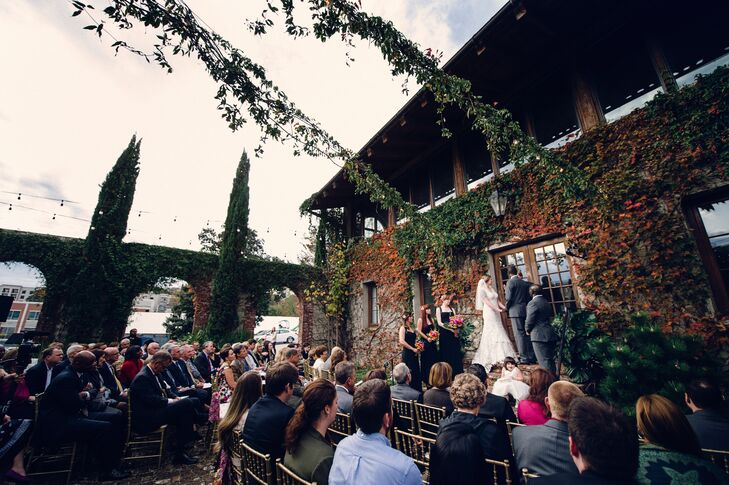 The ceremony took place in the courtyard at Summerour Studio in Atlanta, Georgia, with the fall leaves accenting the bright colors of the Kenyan fabric tied into the chairs in the aisle.