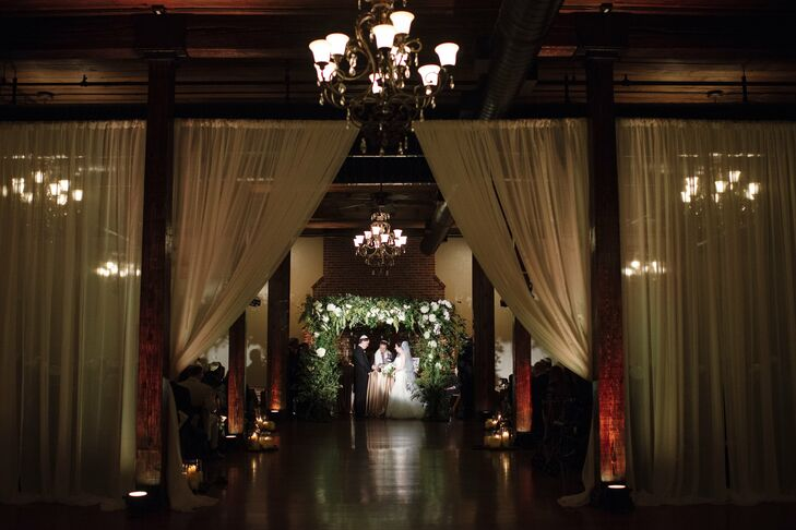 Inside the ceremony area everything was white and green. Curly willow covered all four posts of the huppah, and everything from ivory hydrangeas to phalaenopsis orchids were woven in among all sorts of greenery—hanging amaranthus, seeded eucalyptus and maidenhair fern.
