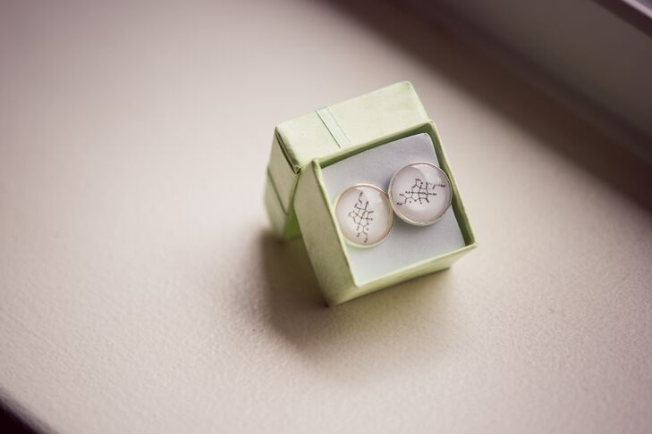 The groom (and chemistry graduate student) appropriately wore chemistry-themed cufflinks.