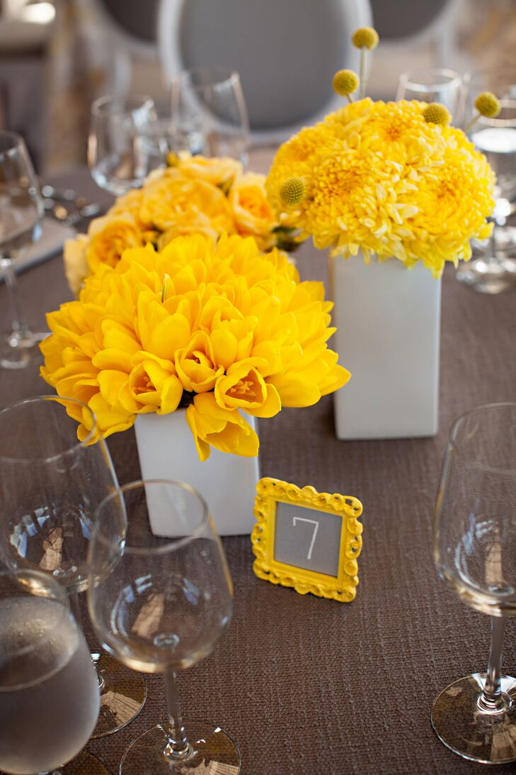 Arrangements of bright-yellow mums, tulips and craspedia topped some tables.