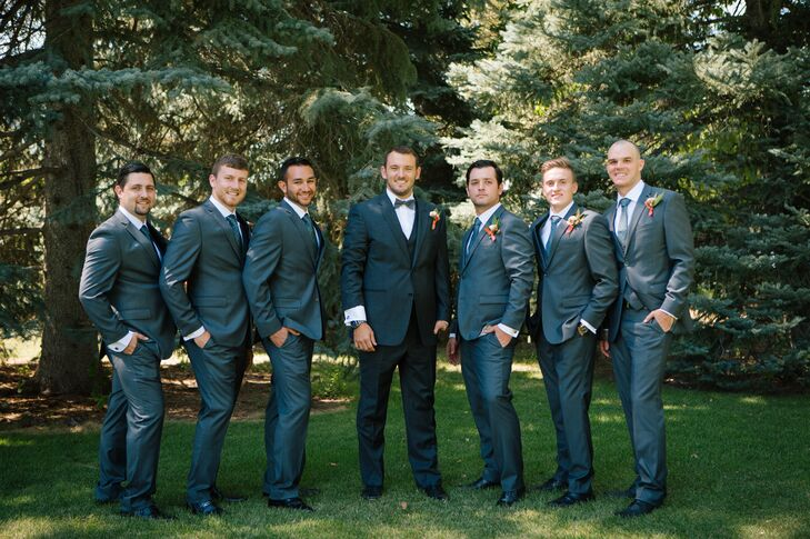 Jonathan wore a dark gray three-piece suit with a dark gray patterned bow tie—his groomsmen sported the same three-piece dark gray suit but their ties had subtle accents that matched the pale aqua bridesmaid dresses.