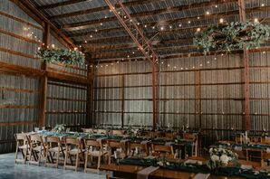 Rustic Barn Reception with Hanging Greenery and String Lights