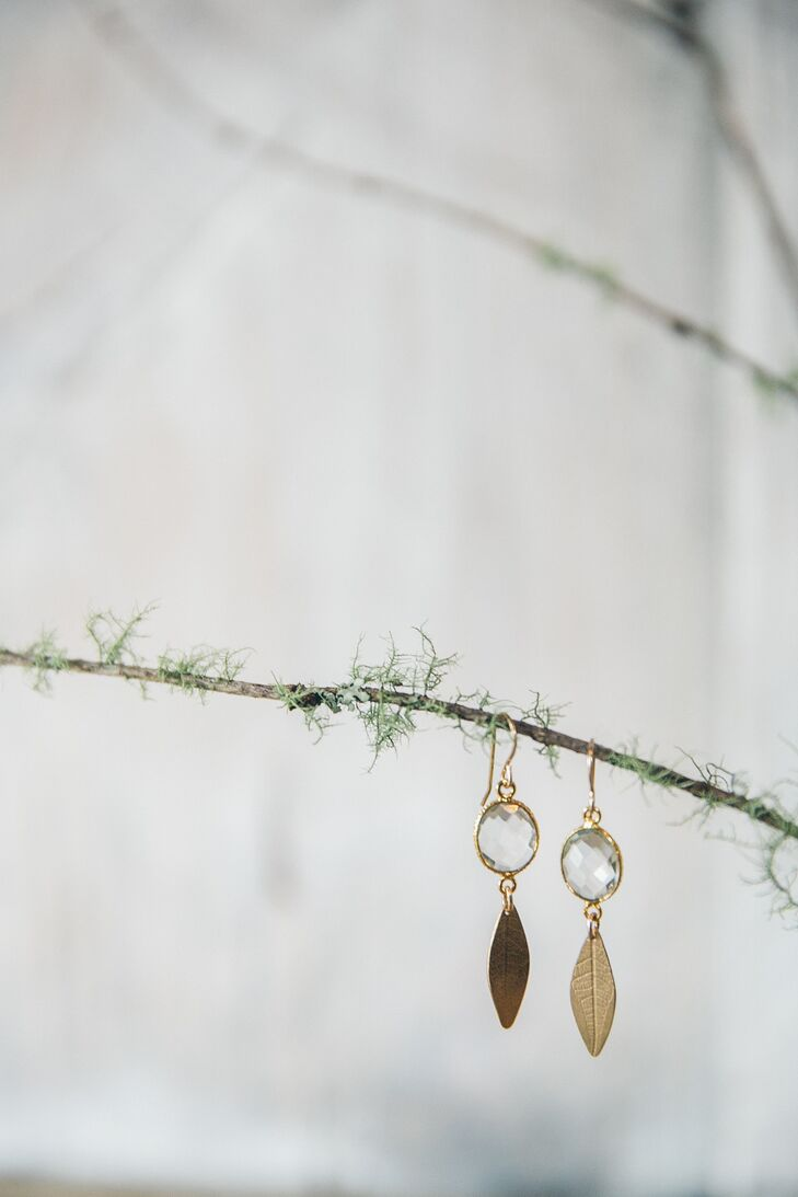 Jayme's gold jewelry contributed to the wedding's bohemian look. She sported a pair of gold-leaf dangling earrings accented with crystals, which matched her long gold-leaf charm necklace.