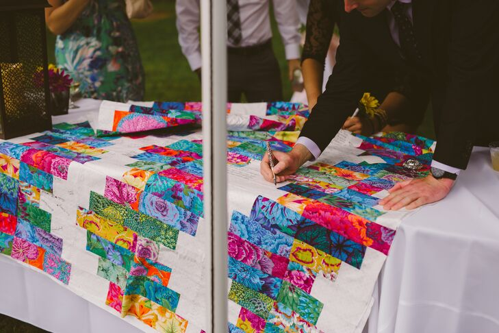 Mary's mother and sister-in-law surprised the newlyweds with a colorful floral quilt for the reception at Gilfillan Farm in Upper St. Clair, Pennsylvania. Guests were invited to write their well-wishes on the quilt's empty spaces in lieu of a guest book.
