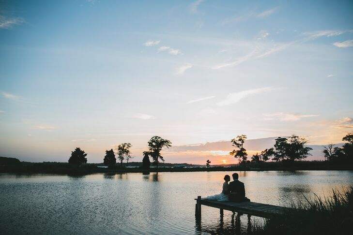 Jess and Dan sat on the dock that overlooked the water in Annapolis, Maryland. The first time Dan had visited Jess at home, they sat on the dock and watched the sunset, not knowing what the future held. On their wedding day, they sat on the dock and looked out toward the sunset, never being more sure of the future ahead.