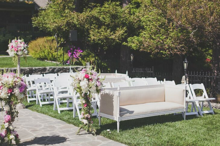 A mix of white garden chairs and vintage couches made up the ceremony seating.