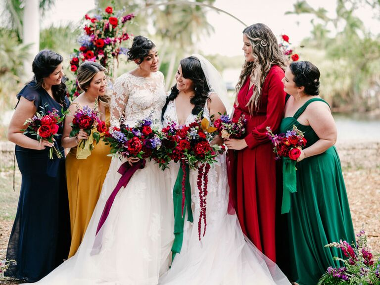 Brides with bridesmaids in colorful jewel-tone dresses with bright bouquets