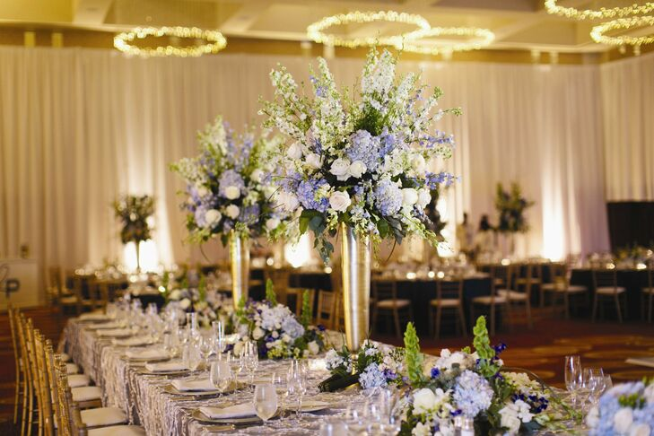 The ballroom at the Four Seasons provided an ideal space for Becca and Phil's elegant reception. The couple worked with an ivory, champagne, gold, blue and green color palette, which they incorporated into every detail from the textured linens to the showy floral arrangements and lighting for a sophisticated, Kate Spade inspired look.