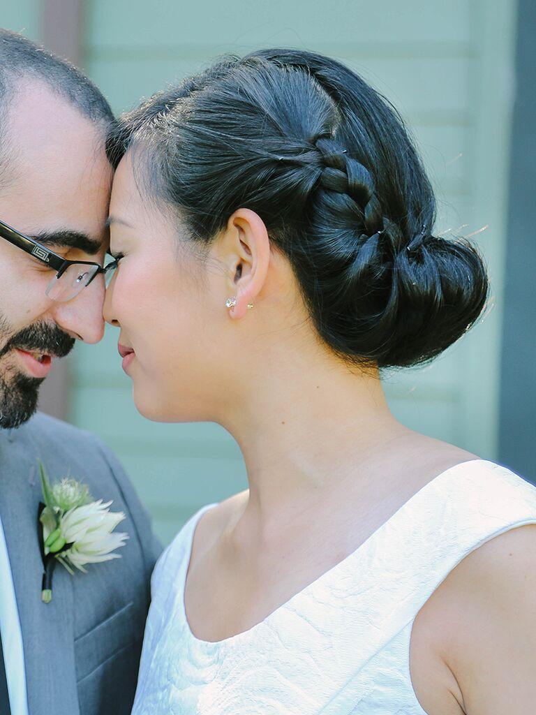 Sleek Tucked Low Bun Wedding Hairstyle With Twisted Braids