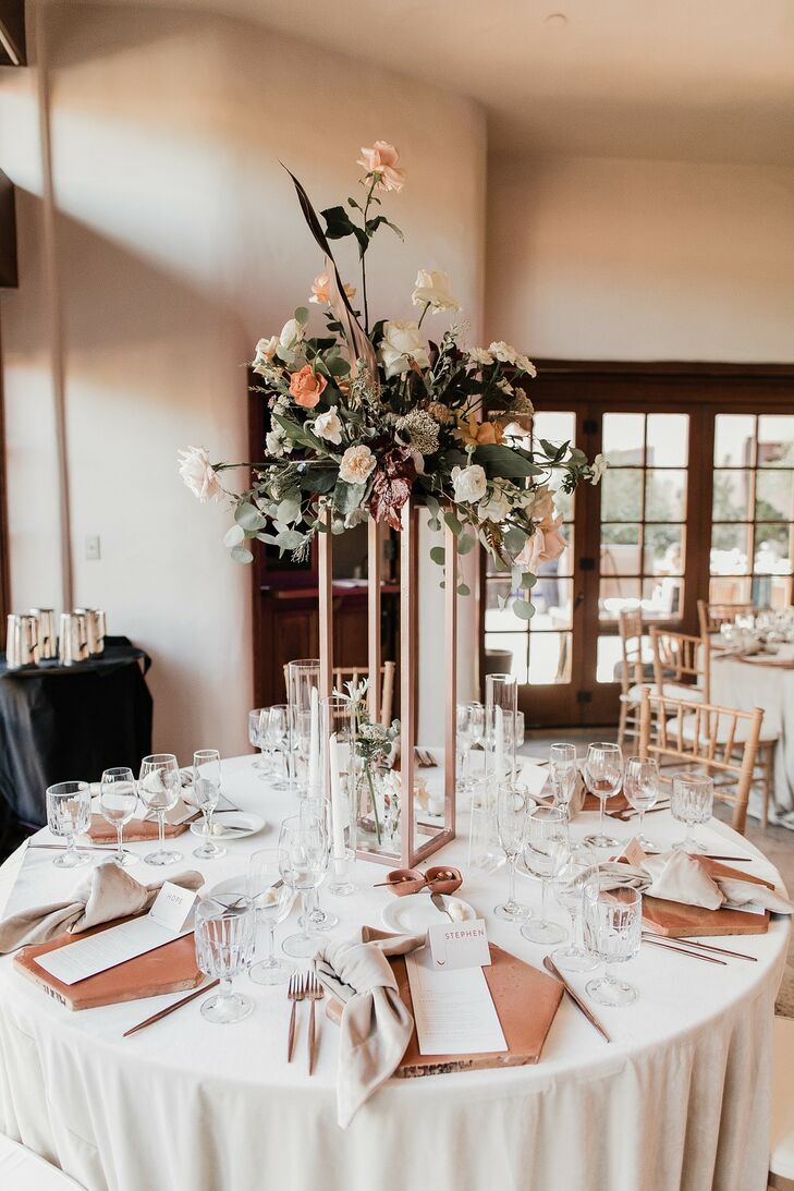 Romantic Dining Table with Tall Flower Centerpieces and Dusty Pink Accents