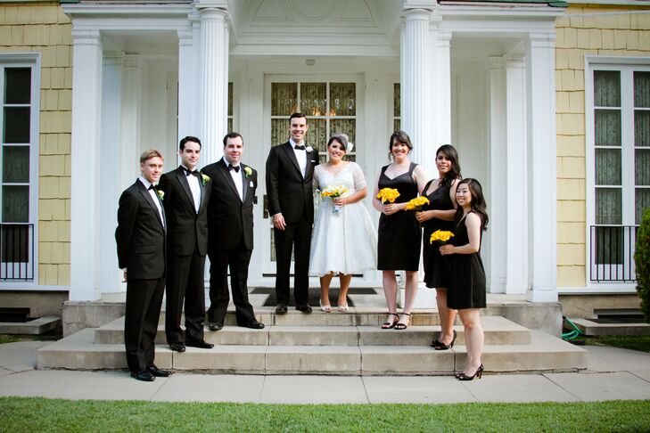 Brandy and John stood with their wedding party on the steps of the Lindley-Scott House in Azusa, California, where the couple got married. The bridesmaids wore simple black cocktail dresses and held their bouquets of canary yellow calla lilies. The groomsmen wore vintage-inspired black tuxedos from the Great Gatsby Collection by Brooks Brothers.
