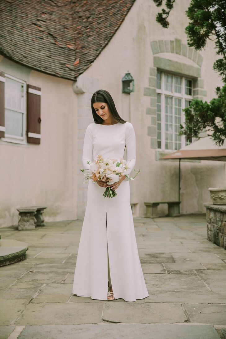 Bride in Modern, Long-Sleeve Wedding Dress with Dramatic Slit