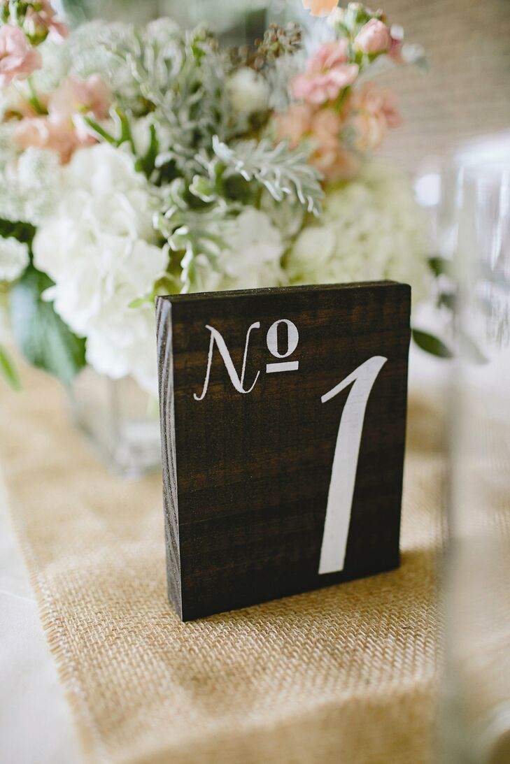 The table numbers were painted on wooden blocks that the bride purchased on etsy.com.