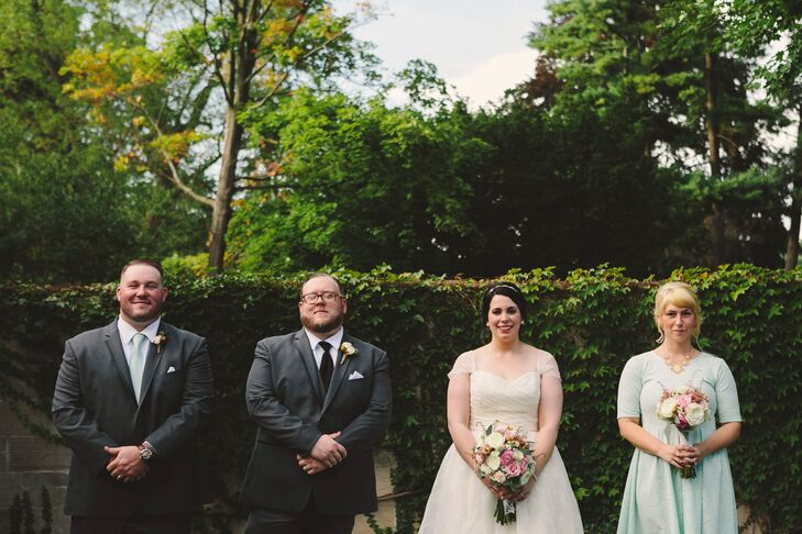 """The maid of honor wore a knee-length, mint dress with half sleeves and lace detail. """"It had a scalloped lace design that matched the lace detail on the bottom of my own gown,"""" the bride says. """"Both of our dresses complemented each other very well."""""""