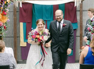 """Caroline and Mike initially imagined """"having a 250+ person evening winter wedding with all of our friends and family, tons of dancing, and a big brida"""