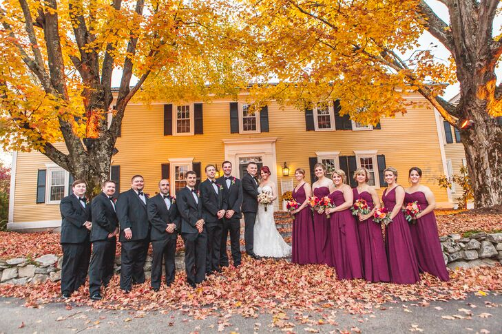 For their wedding party's attire, Sarah and Sean wanted a classic, semi-formal look that captured the day's autumnal feel. The bridesmaids donned floor-length A-line gowns with strapless, v-shaped and one-shoulder necklines in a bright shade of burgundy, while the groomsmen wore classic charcoal gray suits with burgundy calla lily boutonnieres to complement the girls.