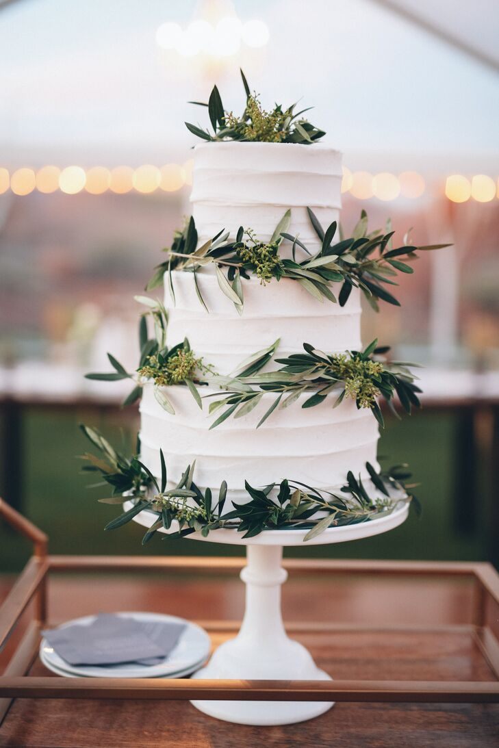 A simple olive branch on the wedding cake adds a touch of cost-effective greenery.