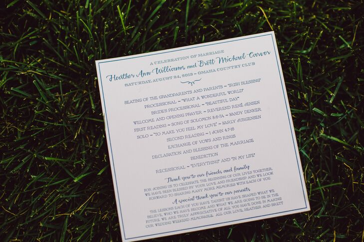 The couple chose square programs for their ceremony with navy letterpress lettering.