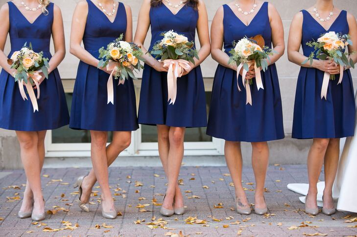 Angela's bridesmaids wore a comfortable silk Faille dress from Flutter Bridesmaids in Minneapolis. The color was a combination of Royal Blue and Navy. They accessorized with fun necklaces from Lizzibeth, owned by the brides college friend, and earrings from Banana Republic.